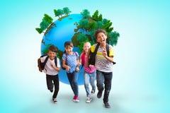 Imagen compuesta de los alumnos lindos que corren abajo del pasillo Foto de archivo libre de regalías