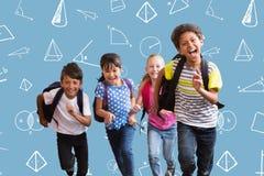 Imagen compuesta de los alumnos lindos que corren abajo del pasillo Fotografía de archivo libre de regalías