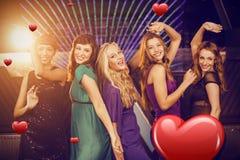 Imagen compuesta de los amigos sonrientes que bailan en sala de baile Imagen de archivo libre de regalías
