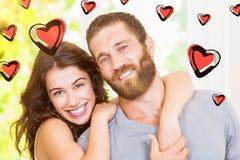 Imagen compuesta de los corazones 3d de los pares y de las tarjetas del día de San Valentín Foto de archivo