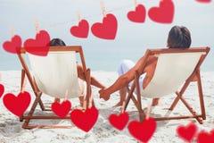 Imagen compuesta de los corazones que cuelgan en una línea Fotos de archivo