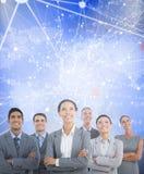 Imagen compuesta de los hombres de negocios que miran para arriba en oficina Imagen de archivo