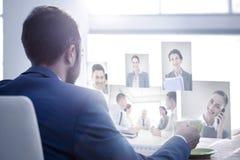 Imagen compuesta de los hombres de negocios que tienen una reunión Fotografía de archivo libre de regalías