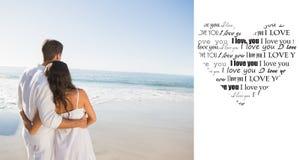 Imagen compuesta de los pares contentos que miran el mar Foto de archivo libre de regalías