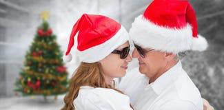 Imagen compuesta de los pares de la Navidad imagen de archivo libre de regalías
