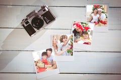 Imagen compuesta de los pares felices que celebran la Navidad en casa Fotos de archivo libres de regalías