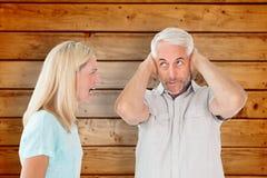 Imagen compuesta de los pares infelices que tienen una discusión con el hombre que no escucha Foto de archivo libre de regalías