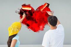 Imagen compuesta de los pares jovenes felices que pintan junto Imagenes de archivo