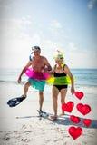 Imagen compuesta de los pares mayores y de los corazones flotantes 3d del amor Foto de archivo