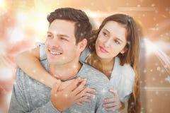 Imagen compuesta de los pares que abrazan con los brazos alrededor y que miran lejos Foto de archivo libre de regalías