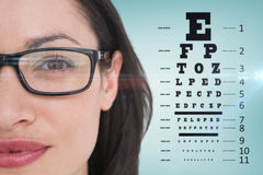 Imagen compuesta de los vidrios morenos bonitos del ojo que llevan Foto de archivo libre de regalías