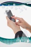 Imagen compuesta de manos usando el teléfono elegante Foto de archivo
