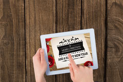 Imagen compuesta de manos usando la PC de la tableta Imagen de archivo libre de regalías