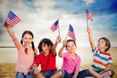 Imagen compuesta de niños con las banderas americanas Imagen de archivo