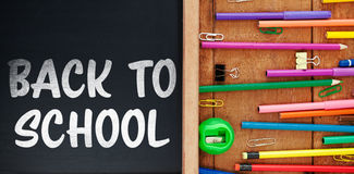 Imagen compuesta de nuevo al texto de escuela en el fondo blanco Imagen de archivo libre de regalías