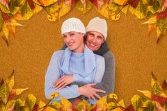 Imagen compuesta de pares casuales en ropa caliente fotos de archivo libres de regalías
