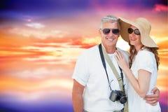 Imagen compuesta de pares vacationing Imagen de archivo libre de regalías