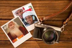 Imagen compuesta de santa feliz que sostiene un regalo que brilla intensamente Fotografía de archivo