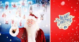 Imagen compuesta de santa que señala al collage de la gente de la Navidad Imágenes de archivo libres de regalías