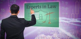 Imagen compuesta de señalar asiático del hombre de negocios Imagen de archivo