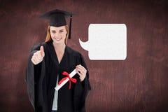 Imagen compuesta del adolescente que celebra la graduación con los pulgares para arriba Imágenes de archivo libres de regalías