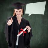 Imagen compuesta del adolescente que celebra la graduación con los pulgares para arriba Imagen de archivo libre de regalías