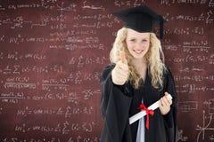 Imagen compuesta del adolescente que celebra la graduación con los pulgares para arriba Imagenes de archivo