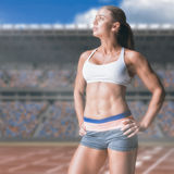 Imagen compuesta del atleta de sexo femenino que presenta con las manos en cadera Fotografía de archivo libre de regalías