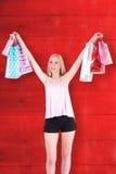Imagen compuesta del blonde bastante joven que sostiene los panieres Fotografía de archivo