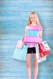 Imagen compuesta del blonde bastante joven que sostiene los panieres Fotografía de archivo libre de regalías