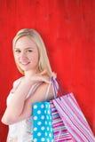 Imagen compuesta del blonde bastante joven que sostiene los panieres Imagenes de archivo