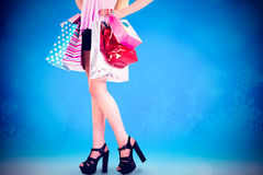 Imagen compuesta del blonde bastante joven que sostiene los panieres Imagen de archivo libre de regalías