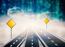 Imagen compuesta del camino sobre las nubes con las señales de tráfico en ella Imagen de archivo libre de regalías