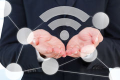 Imagen compuesta del cierre para arriba de la mano de un hombre de negocios 3d Foto de archivo libre de regalías