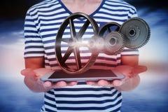 Imagen compuesta del cierre para arriba de la tableta de la tenencia del hombre Fotografía de archivo libre de regalías