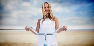 Imagen compuesta del compuesto digital de las mujeres que van en un paseo de la bici Fotos de archivo