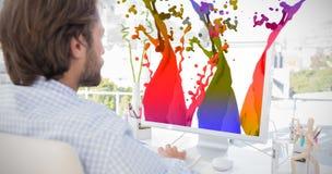 Imagen compuesta del desinger que trabaja en su ordenador Fotografía de archivo libre de regalías