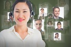 Imagen compuesta del ejecutivo de sexo femenino sonriente hermoso con las auriculares Fotos de archivo libres de regalías