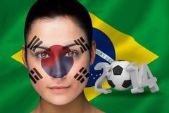 Imagen compuesta del fanático del fútbol de Corea en pintura de la cara Imagen de archivo