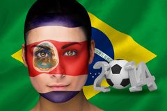 Imagen compuesta del fanático del fútbol de Costa Rica en pintura de la cara Foto de archivo