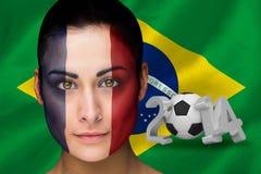 Imagen compuesta del fanático del fútbol de Francia en pintura de la cara Foto de archivo libre de regalías