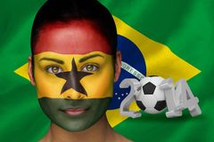 Imagen compuesta del fanático del fútbol de Ghana en pintura de la cara Imagen de archivo libre de regalías