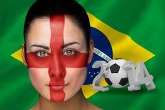Imagen compuesta del fanático del fútbol de Inglaterra en pintura de la cara Imagen de archivo libre de regalías