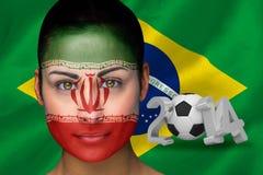 Imagen compuesta del fanático del fútbol de Irán en pintura de la cara Imágenes de archivo libres de regalías