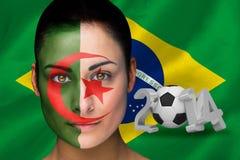 Imagen compuesta del fanático del fútbol de Irán en pintura de la cara Fotografía de archivo
