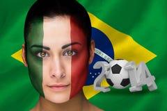 Imagen compuesta del fanático del fútbol de Italia en pintura de la cara Imagen de archivo