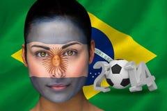 Imagen compuesta del fanático del fútbol de la Argentina en pintura de la cara Foto de archivo