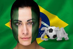 Imagen compuesta del fanático del fútbol de Nigeria en pintura de la cara Foto de archivo