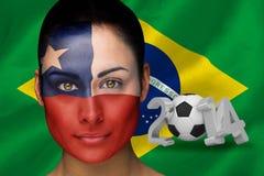 Imagen compuesta del fanático del fútbol del chile en pintura de la cara Fotografía de archivo