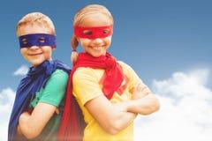 Imagen compuesta del hermano y de la hermana felices en máscara del cabo y de ojo Foto de archivo libre de regalías